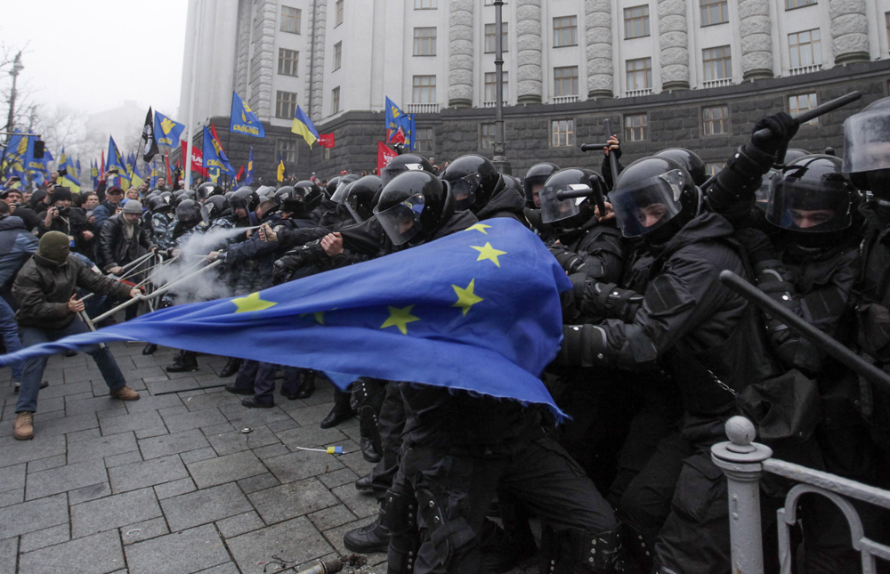 Protesters clash with riot police during a rally to support EU integration in Kiev