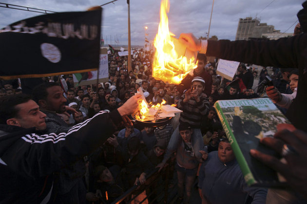 People burn Green Book and pictures of Muammar Gaddafi in Benghazi