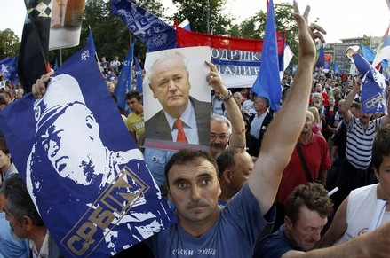 Supporters of Serbian Radical Party holds posters of Milosevic and Mladic during a protest against the arrest of Mladic in Belgrade
